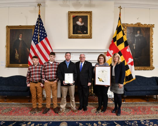 Gov. Larry Hogan presents an official citation to the members of the Chaffey family of Marion Station on Jan. 27 during the 2020 Century Farm ceremony at the State House in Annapolis.