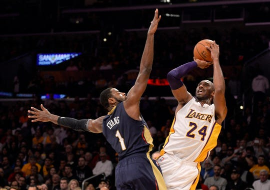 Dec 7, 2014; Los Angeles, CA, USA; Los Angeles Lakers guard Kobe Bryant (24) shoots over New Orleans Pelicans forward Tyreke Evans (1) during the game at Staples Center. Mandatory Credit: Richard Mackson-USA TODAY Sports