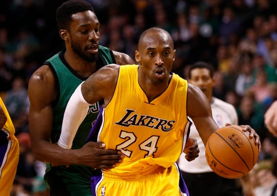 Dec 5, 2014; Boston, MA, USA; Los Angeles Lakers guard Kobe Bryant (24) drives to the hoop against Boston Celtics forward Jeff Green (back) during the second half at TD Garden. Mandatory Credit: Mark L. Baer-USA TODAY Sports