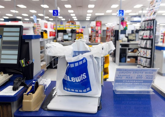 A rack of plastic bags sits on the counter of a customer service station on Tuesday, Jan. 28, at Lewis Drug in Sioux Falls. May has worked for Lewis Drug for 8 years.