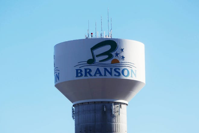 A water tower in a News-Leader file photo shows a Branson, Missouri logo. Taney County Health Department news releases show that the county's number of documented COVID-19 cases increased from 146 cases on the morning of July 17, 2020, to 216 cases on the evening of July 24, 2020.