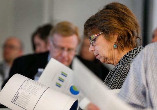 Springfield City Council Member Phyllis Ferguson looks through a book as consultants present their findings during a Forward SGF meeting on Tuesday, Jan. 28, 2020.