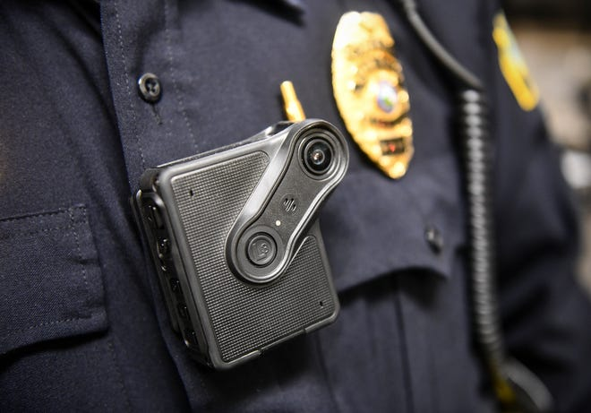 Sauk Rapids Police Chief Perry Beise demonstrates a body camera planned for use by the department Tuesday, Jan. 28, 2020, at the Sauk Rapids Government Center.