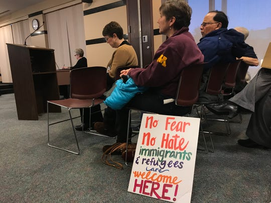 "Kris Vonnegut attended the Stearns County board meeting on Tuesday, Jan. 28, 2020, in St. Cloud with a sign that read: ""No fear no hate. Immigrants and refugees are welcome here!"""