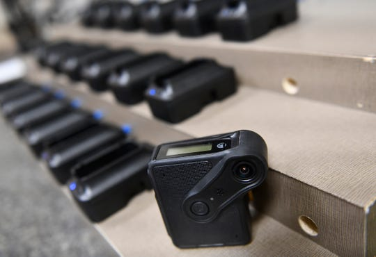 Body cameras are pictured next to the downloading and charging station Tuesday, Jan. 28, at the Sauk Rapids Police Department.