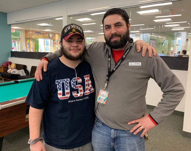 Abel Cordero, this year's Boys & Girls Clubs of Central Minnesota's Youth of the Year, stands with Tony Bown, director of the Eastside Unit.