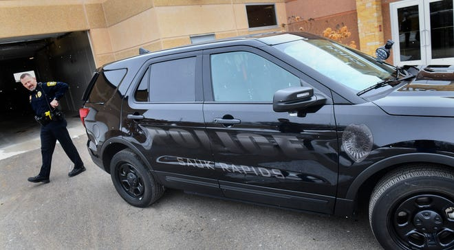 Sauk Rapids Police Chief Perry Beise walks past patrol car designed for stealthy traffic patrol Tuesday, Jan 28, 2020, at the Sauk Rapids Government Center.