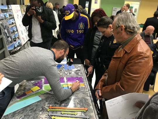Citizens look over diagrams of Northwood Centre in one of several public workshops to help find the next site of the Tallahassee Police Department's headquarters.