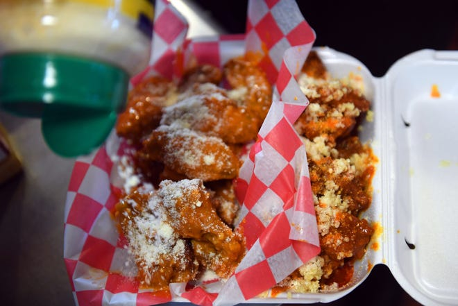 """A favorite place to find chicken wings in Vero Beach is at Phatz Chick-n-Shack at 4211 20th Street. """"The best seller we have is our chicken wings with our signature Finger Lickin' sauce,"""" said owner Roscoe Barber. """"Super Bowl Sunday is going to be real busy around here. Everybody loves a good wing."""""""