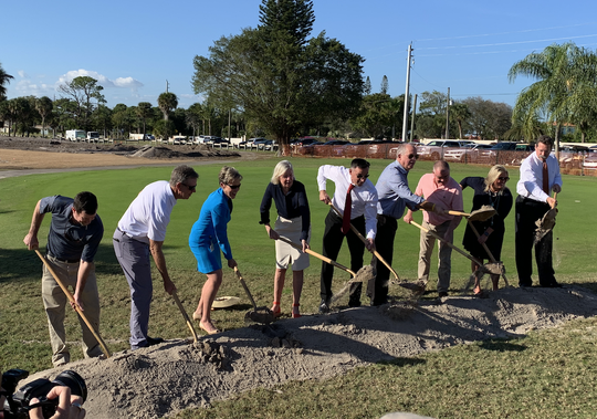 Martin County officials take part in groundbreaking at the Martin County Golf Course. The county-owned golf course is converting one of its 18-hole courses into a nine-hole course that can be played in reverse.