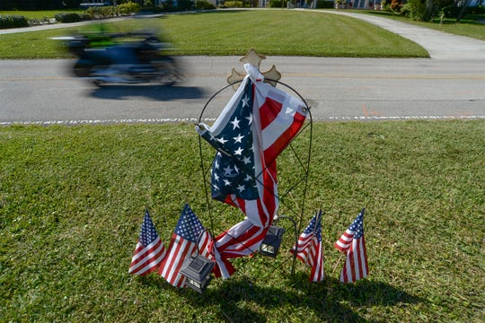 A northbound motorcyclist passes a memorial marker for a fellow motorcyclist, along the 2000 block of South Indian River Drive, on Tuesday, Jan. 28, 2020, in Fort Pierce. According to Fort Pierce Police spokeswoman April Lee, Zachary Monreal, 30, of Port St. Lucie, died after he lost control of his motorcycle on Thursday, Jan. 23, while riding southbound on Indian River Drive, and crossed over into the northbound lane and was struck by a northbound vehicle.