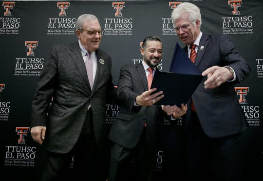 State Rep. Cesar Blanco presents Texas Tech University Health Sciences Center El Paso President and Paul L. Foster School of Medicine Dean Richard Lange with a proclamation alongside El Paso Mayor Dee Margo Tuesday, Jan. 28, 2019. The medical school is celebrating its 10-year anniversary.