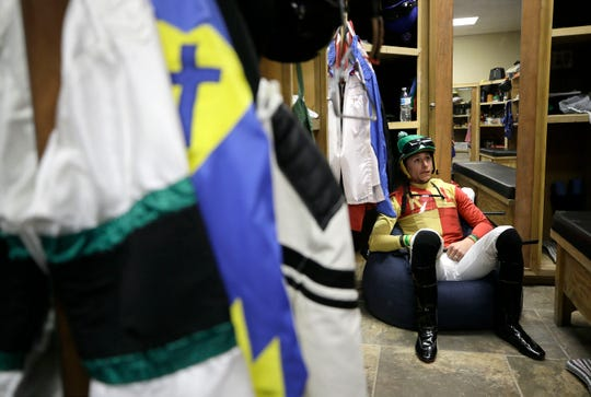Francisco Arrieta waits for his mount aboard Sky Defence in the second race Tuesday at Sunland Park Racetrack and Casino. Arrieta has become of the top jockeys at the track.