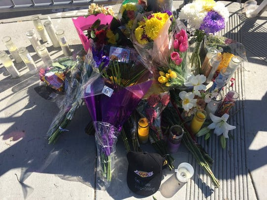 Flowers and candles sit on the sidewalk at Las Virgenes Road and Willow Glen Street in Calabasas, California, on Monday, Jan. 27, 2020.