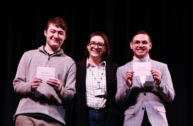 (From left) Jeremy Rasmussen, winner, Vineland High School's Poetry Out Loud contest; Vanessa Rasmussen, event organizer, Advanced Placement English teacher and department chairperson at the high school; and Geovanni Perez, contest runner-up, take the stage at the conclusion of the contest.