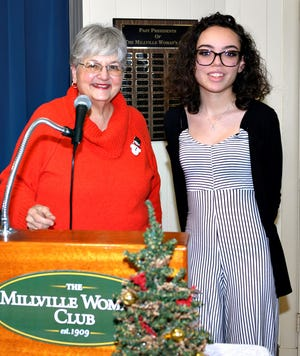 Donna Pio (left), education chairperson, Millville Woman's Club, and Alyssa Santiago, a student at Millville High School.
