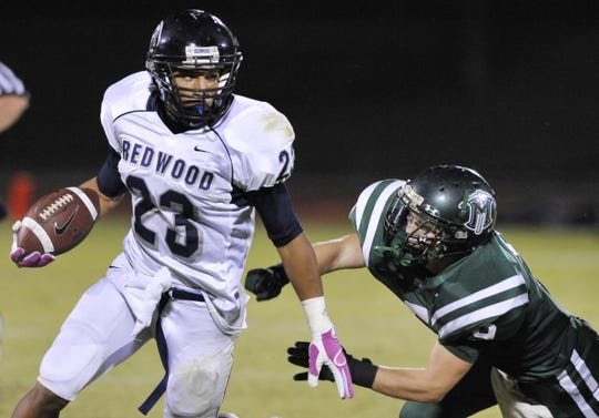 Redwood's Dillon Root, left, escapes El Diamante's Brandon Hughes in the second quarter at Groppetti Automotive Community Stadium on Friday, October 29, 2010.