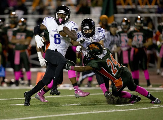 Mission Oak's Elijah Porchia (6) carries the ball against Porterville at Rankin Stadium in 2013.