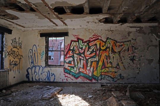 A view inside of the 23,0000 square foot New Rochelle Armory on Jan. 24, 2020, is covered with graffiti and peeling paint due being neglected for decades. The New Rochelle Armory which the city bought from the state for $1 in 1997 is finally undergoing renovations.