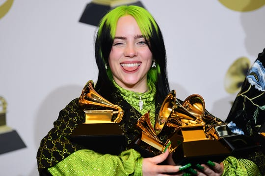 Singer/songwriter Billie Eilish poses in the press room with the awards for Album Of The Year, Record Of The Year, Best New Artist, Song Of The Year and Best Pop Vocal Album during the 62nd Annual Grammy Awards on January 26, 2020, in Los Angeles.