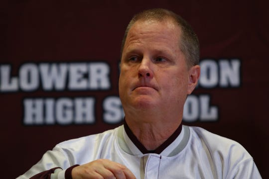 Kobe Bryant's high school basketball coach, Gregg Downer, speaks emotionally about the player's life at Lower Merion High School in Ardmore, Pa. on Tuesday.
