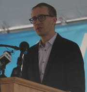 Daniel Shurz, Senior Vice President of Commercial at Frontier Airlines, speaks at a press conference Tuesday announcing the airlines return to the New Castle Airport.