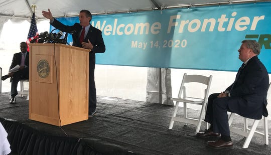 Gov. John Carney speaks at a press conference Tuesday announcing the return of Frontier Airlines to the New Castle Airport.
