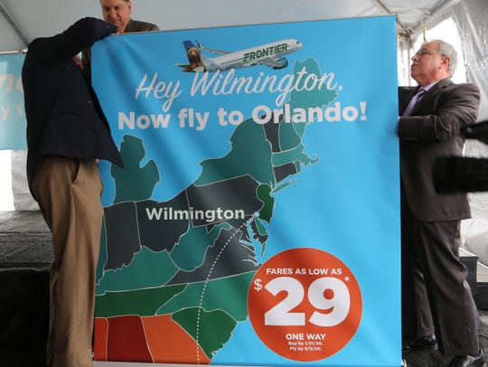 A banner unveils Frontier Airlines flights from Wilmington to Orlando.