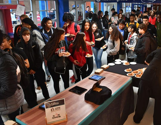 Hirschi High School students stop for samples during a Student Choice event to help Chartwells K12 decide on a new menu item.