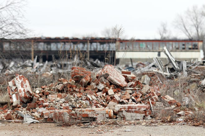 A pile of rubble on the former Lear property on Linden Avenue in Zanesville. The ruins of the former factory had been a source of controversy in the city for years.