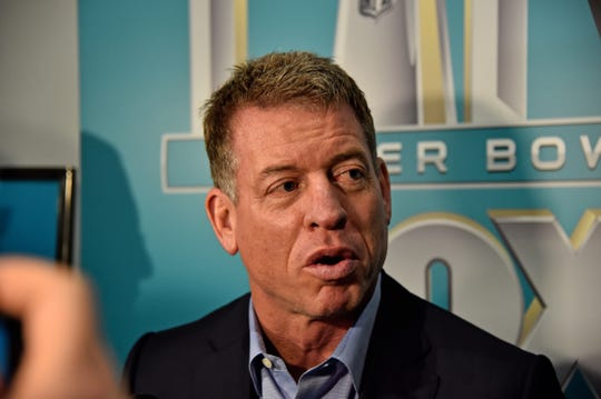 Fox Sports broadcaster Troy Aikman speaks with the media during Fox Sports media day at the Miami Beach convention center.