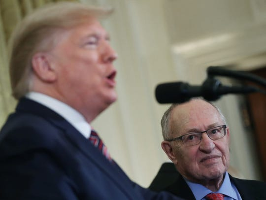 Professor and attorney Alan Dershowitz listens to President Donald Trump speak during a Hanukkah reception in the East Room of the White House on Dec. 11, 2019.