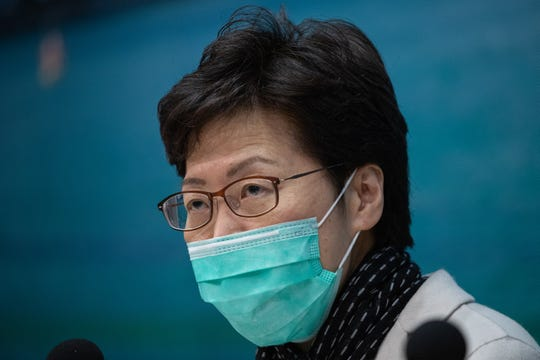 Hong Kong Chief Executive Carrie Lam wore a surgical mask during a Tuesday press conference where she announced that all rail and ferry routes between mainland China and Hong Kong will be halted starting at midnight on Thursday.