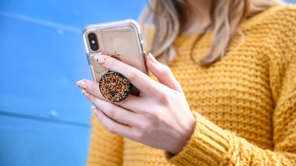 Quit letting your loved ones drop their phones and just buy them a PopSocket already.