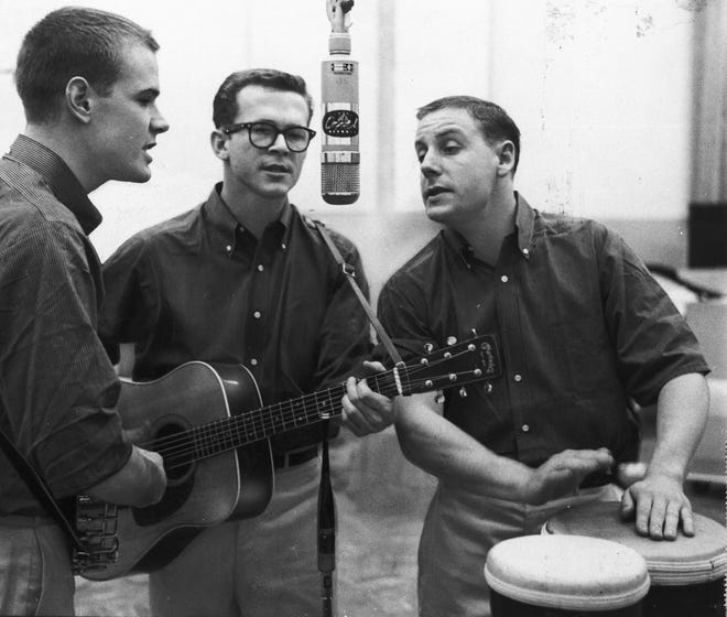 Bob Shane, center, seen with fellow Kingston Trio band members Dave Guard, left, and Nick Reynolds in 1959, died Sunday at 85. He was the last surviving member of the best-selling musical group that led a revival of folk music in the 1950s and 1960s.