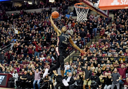 Florida State guard Trent Forrest dunks against Notre Dame during the first half at Donald L. Tucker Center.