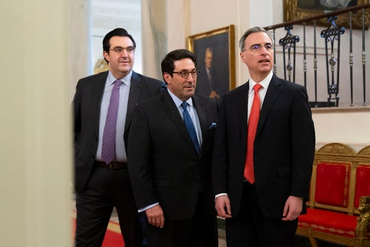Attorneys in the defense team for the Senate impeachment trial of US President Donald J. Trump: Jay Sekulow (C), Jordan Sekulow (L) and White House Counsel Pat Cipollone (R) stand in the White House Cross Hall before the unveiling of US President Donald J. Trump's Middle East peace plan on Tuesday.