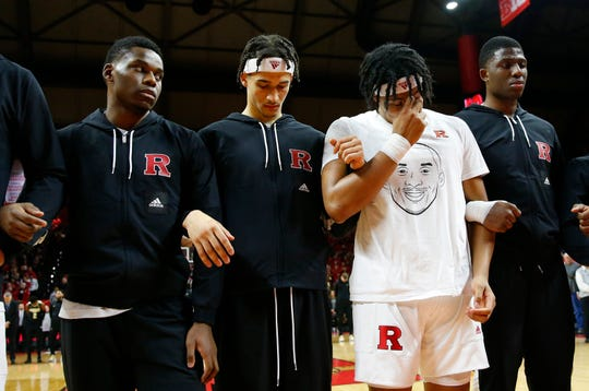 Rutgers Scarlet Knights guard Ron Harper Jr. (24) pauses with teammates during a moment of silence for Kobe Bryant before game against the Purdue Boilermakers