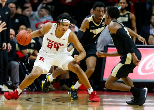 Jan 28, 2020; Piscataway, New Jersey, USA; Rutgers Scarlet Knights guard Ron Harper Jr. (24) dribbles the ball against the Purdue Boilermakers during the first half at Rutgers Athletic Center (RAC).