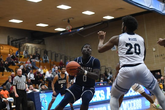 Monmouth's Ray Salnave looks for a shot last season against Saint Peter's at the Uanitelli Center in Jersey City.