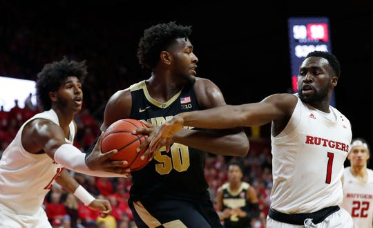 Rutgers Scarlet Knights center Myles Johnson (15) and  forward Akwasi Yeboah (1) defends against Purdue Boilermakers forward Trevion Williams (50)