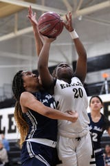 Abilene High's Shaliyah Stevenson (20) goes up for a shot against North Richland Hills Richland's Simara Peyton (11) at Eagle Gym on Tuesday. The game slipped away from the Lady Eagles in the third quarter of their 49-32 loss.