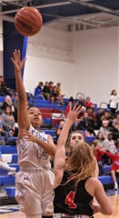 Cooper's Kyla Speights (13) shoots over Aledo's Riley Sale (4) in the first half. Cooper beat the Ladycats 37-30 in the District 4-5A game Tuesday at Cougar Gym.