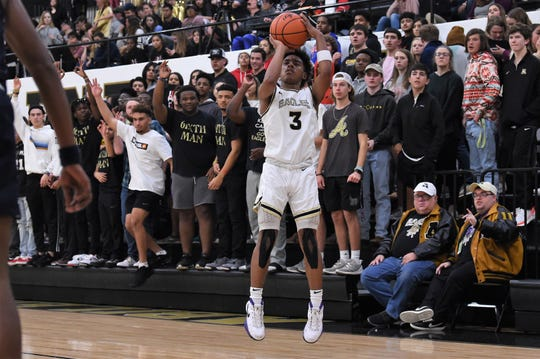 Abilene High's Jalen McGee takes a 3-pointer in front of the student section against North Richland Hills Richland at Eagle Gym on Tuesday. McGee scored a game-high 20 points in the Eagles' 54-50 win.