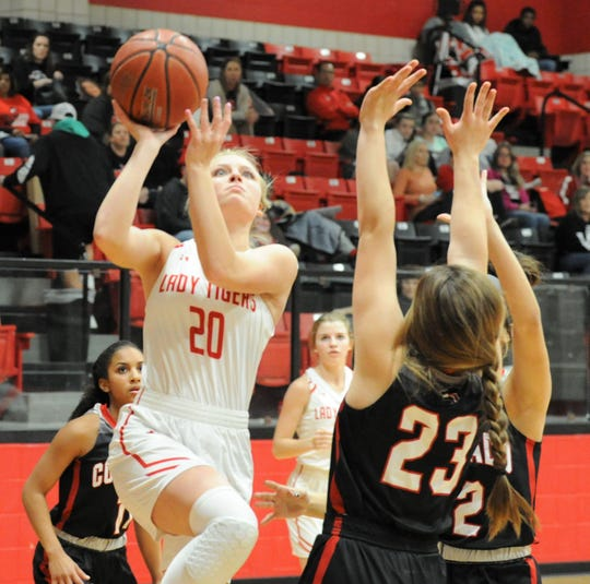 Anson guard Gracie Feagan (20) goes for a shot against Colorado City on Tuesday, Jan. 28, 2020, at Anson High School.