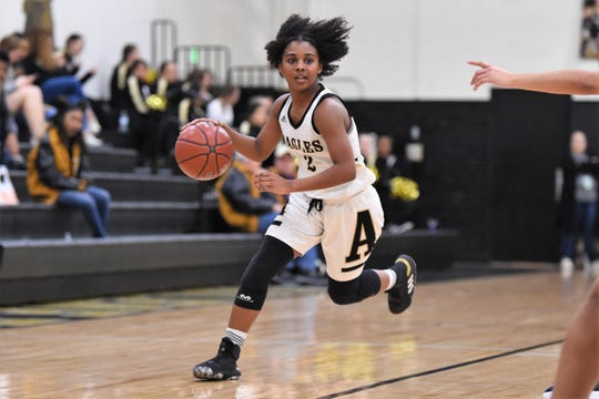 Abilene High's Syncere Reed (2) runs with the ball against North Richland Hills Richland on Tuesday. The game slipped away from the Lady Eagles in the third quarter of their 49-32 loss.