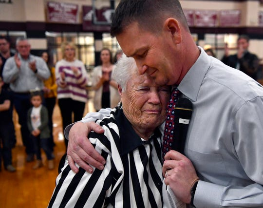 Mary Mosley is hugged by Josh Fostel, the athletic director and head basketball coach at Eula High School, after the gym was renamed in her honor Jan. 24.