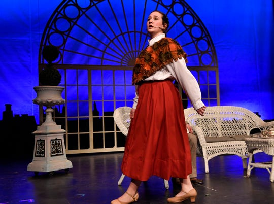 "Cooper High School senior Lia Kish performs as Eliza Dolittle during rehearsal for Cooper's production of ""My Fair Lady"" Tuesday."