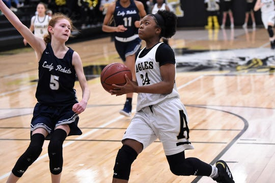 Abilene High's Trakenya Roberson (24) drives to the basket against North Richland Hills Richland at Eagle Gym on Tuesday. The game slipped away from the Lady Eagles in the third quarter of their 49-32 loss.