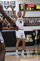 Abilene High's Joe Joe Escobedo (4) follows through on a made 3-pointer against North Richland Hills Richland at Eagle Gym on Tuesday. The Eagles won 54-50 to remain perfect in District 3-6A.